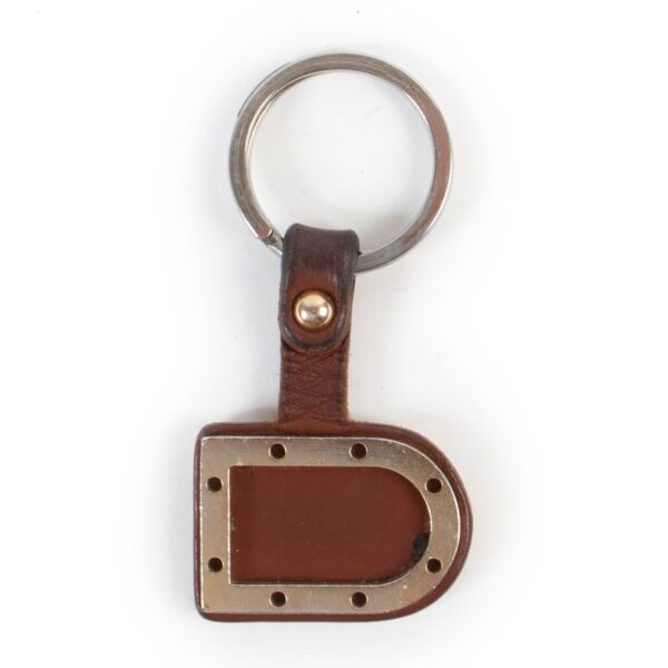 Buy an authentic second hand Delvaux Brown Key Chain at Labellov.