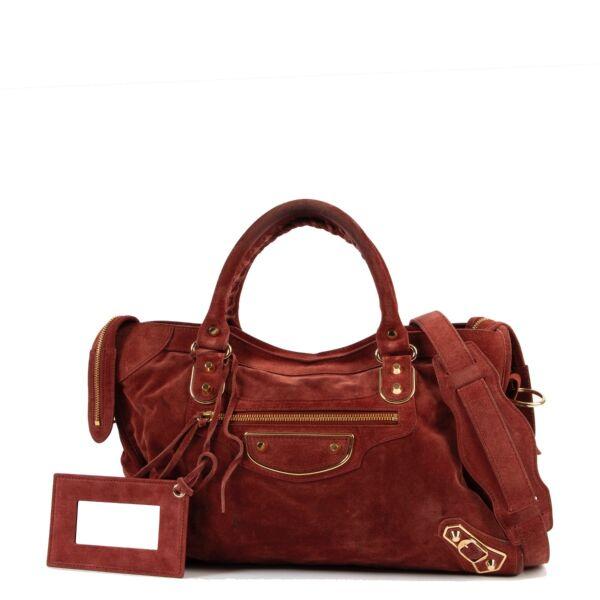 Buy an authentic second hand Balenciaga Suede City bag at Labellov