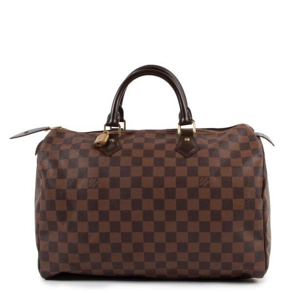 Buy an authentic second hand Louis Vuitton Sac Speedy 35 Damier Ebène at Labellov