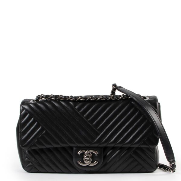 Buy an authentic second hand Chanel Black Timeless Chevron Flap Bag at Labellov