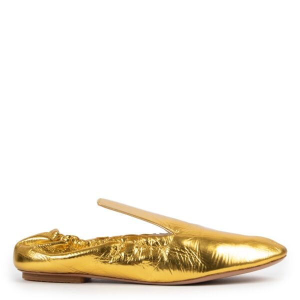 Buy an authentic pair of second hand Dries Van Noten Gold Loafers size 40,5 at Labellov