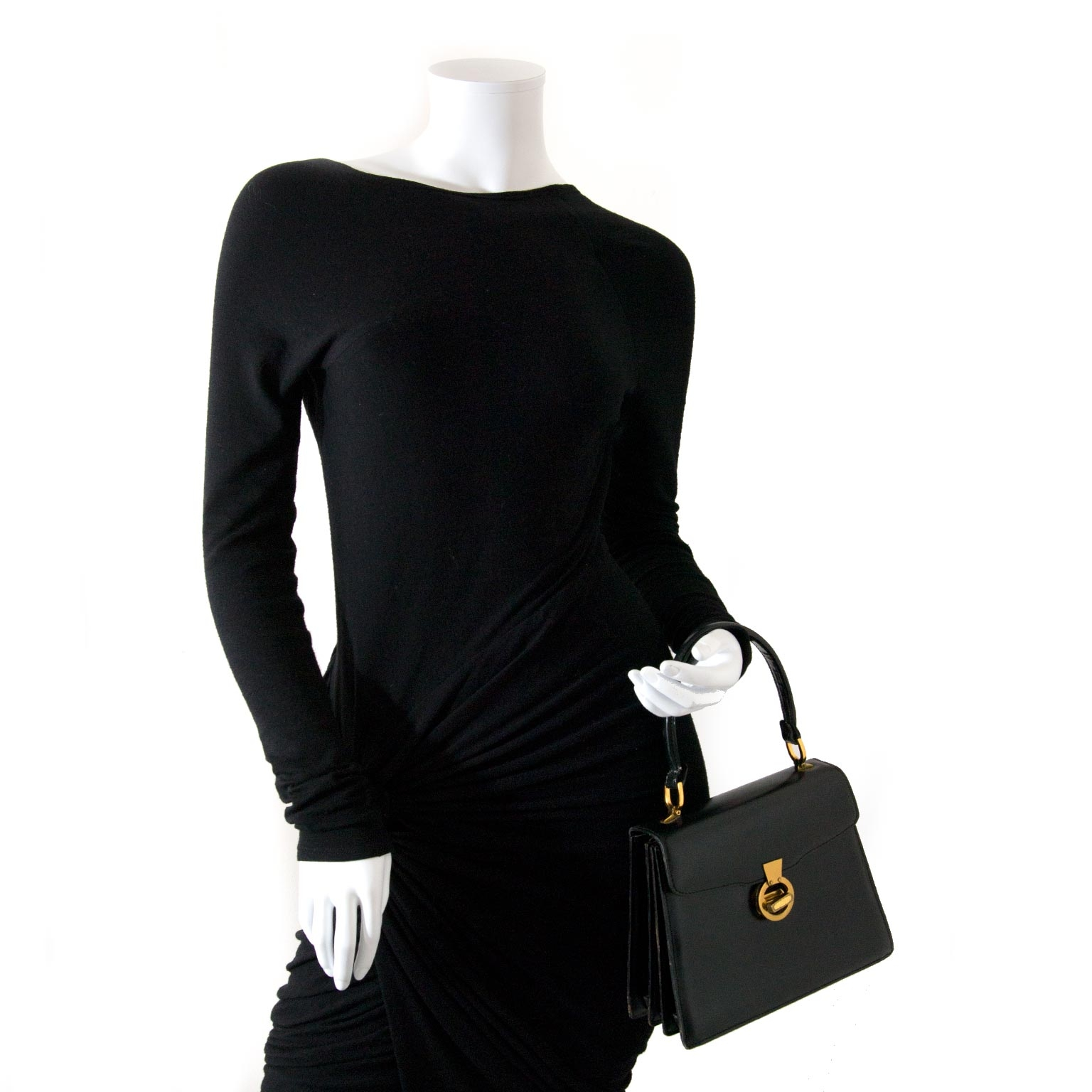 We buy and sell your authentic Delvaux Vintage Black Leather Top Handle Bag