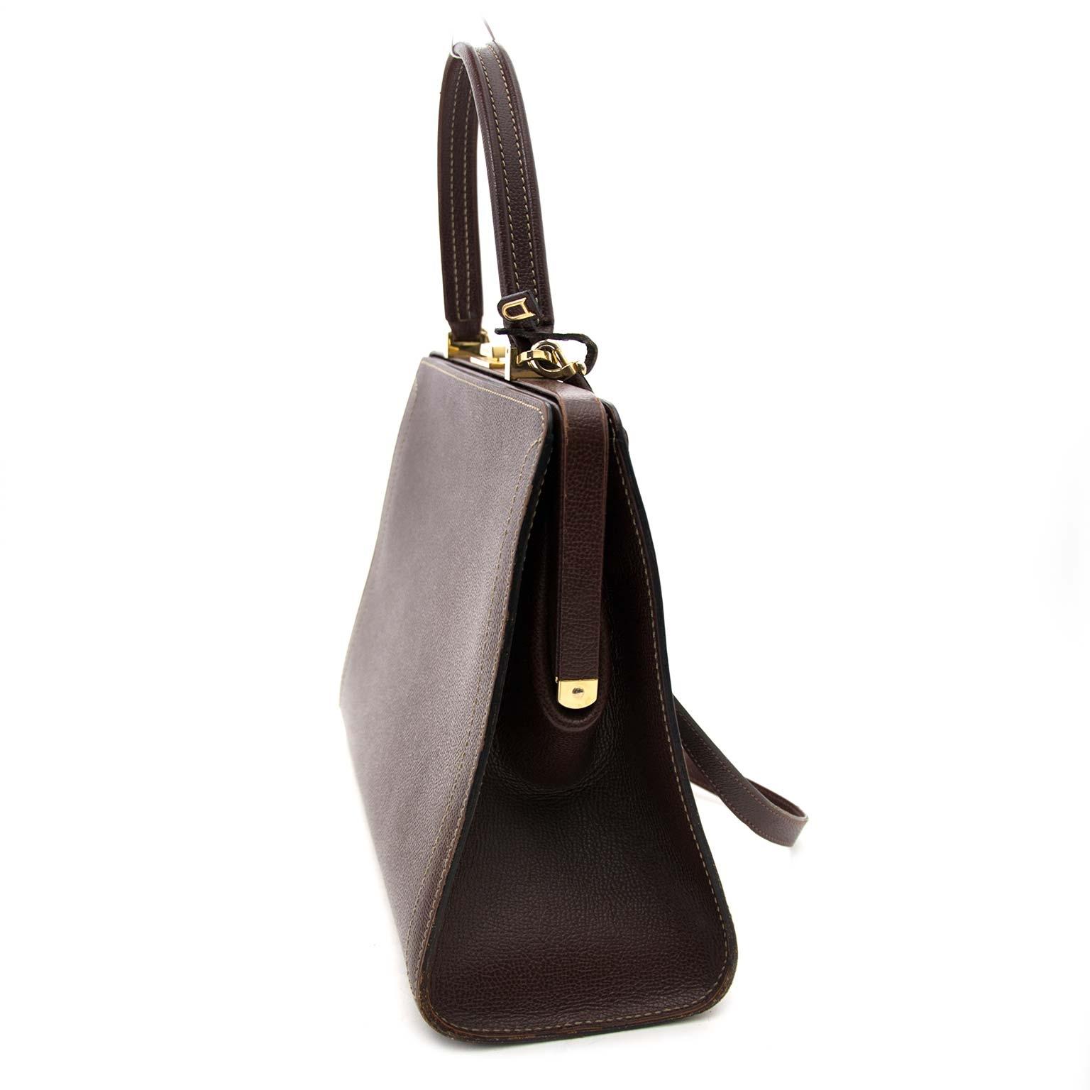 Delvaux Evasion Brown Leather Bag Buy authentic designer Delvaux secondhand bags at Labellov at the best price. Safe and secure shopping. Koop tweedehands authentieke Delvaux tassen bij designer webwinkel labellov.