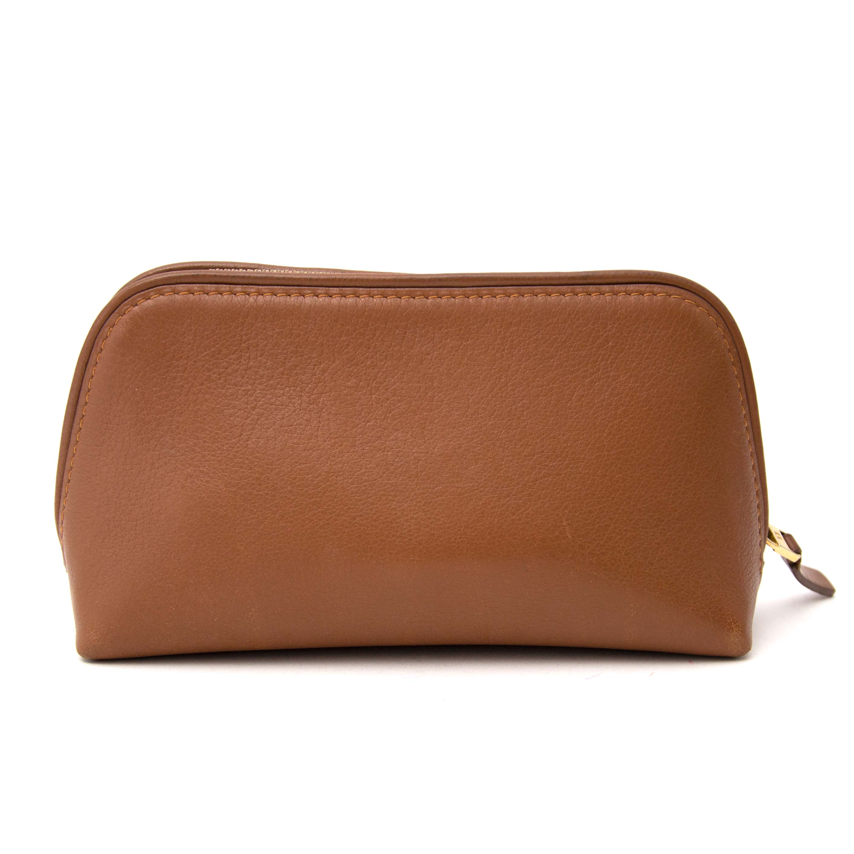 delvaux cognac leather pouch now online at labellov.com