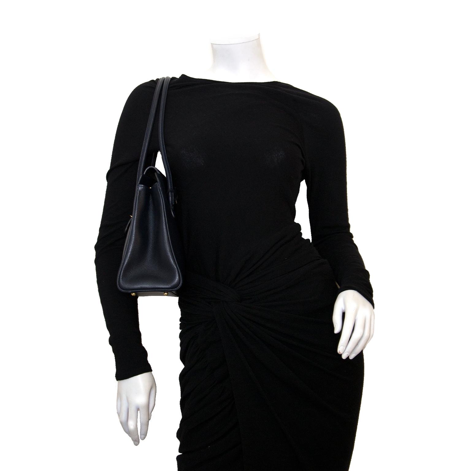 Buy designer Delvaux handbags at Labellov vintage fashion webshop