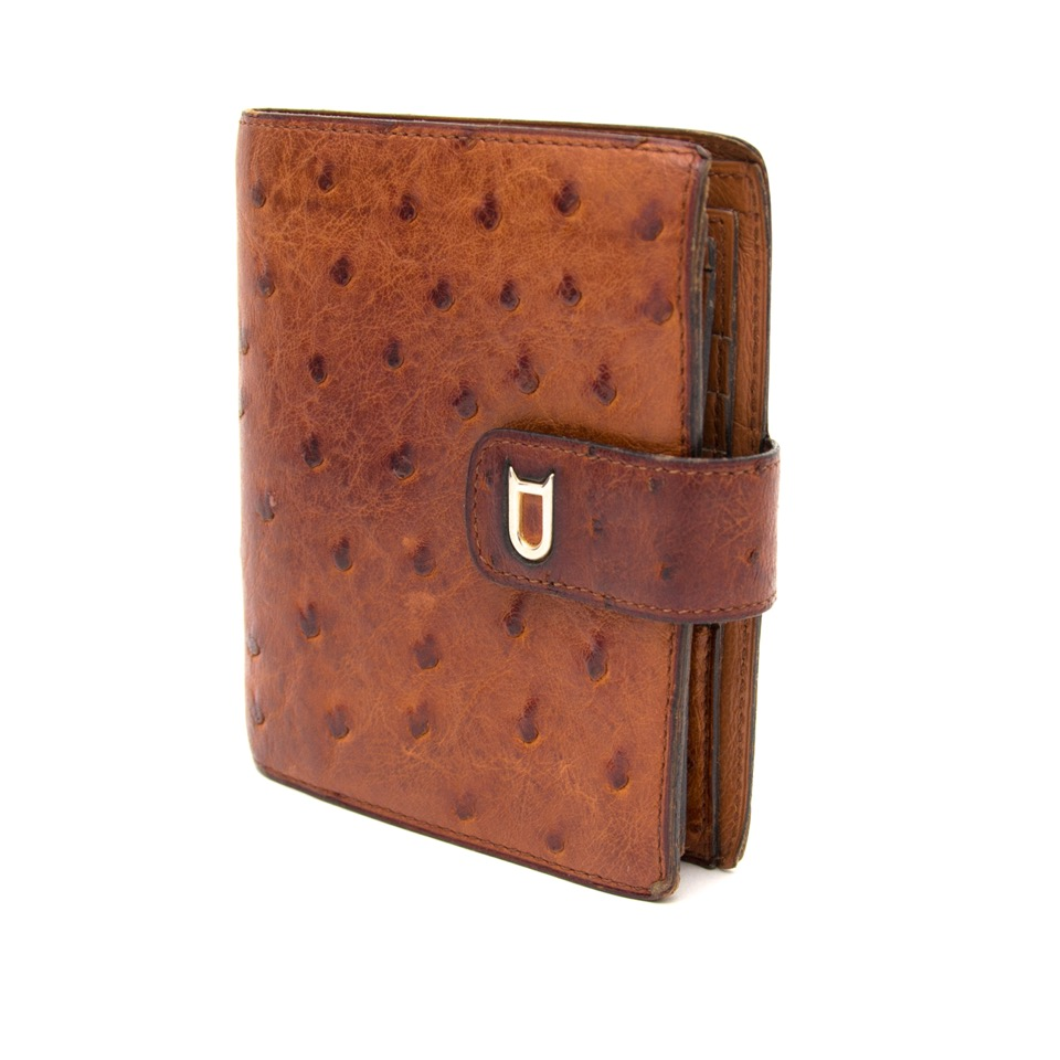Buy and sell your secondhand designer items such as this Delvaux brown ostrich wallet