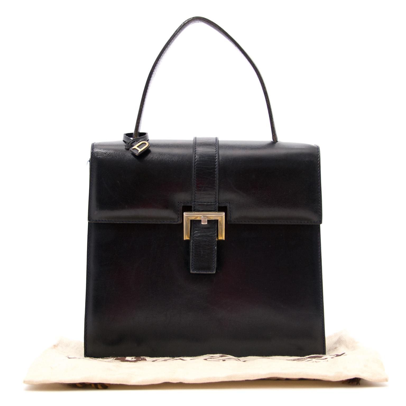 Schwarze Delvaux Modèle Déposé Handtasche heute online auf labellov.com gegen den besten Preis.