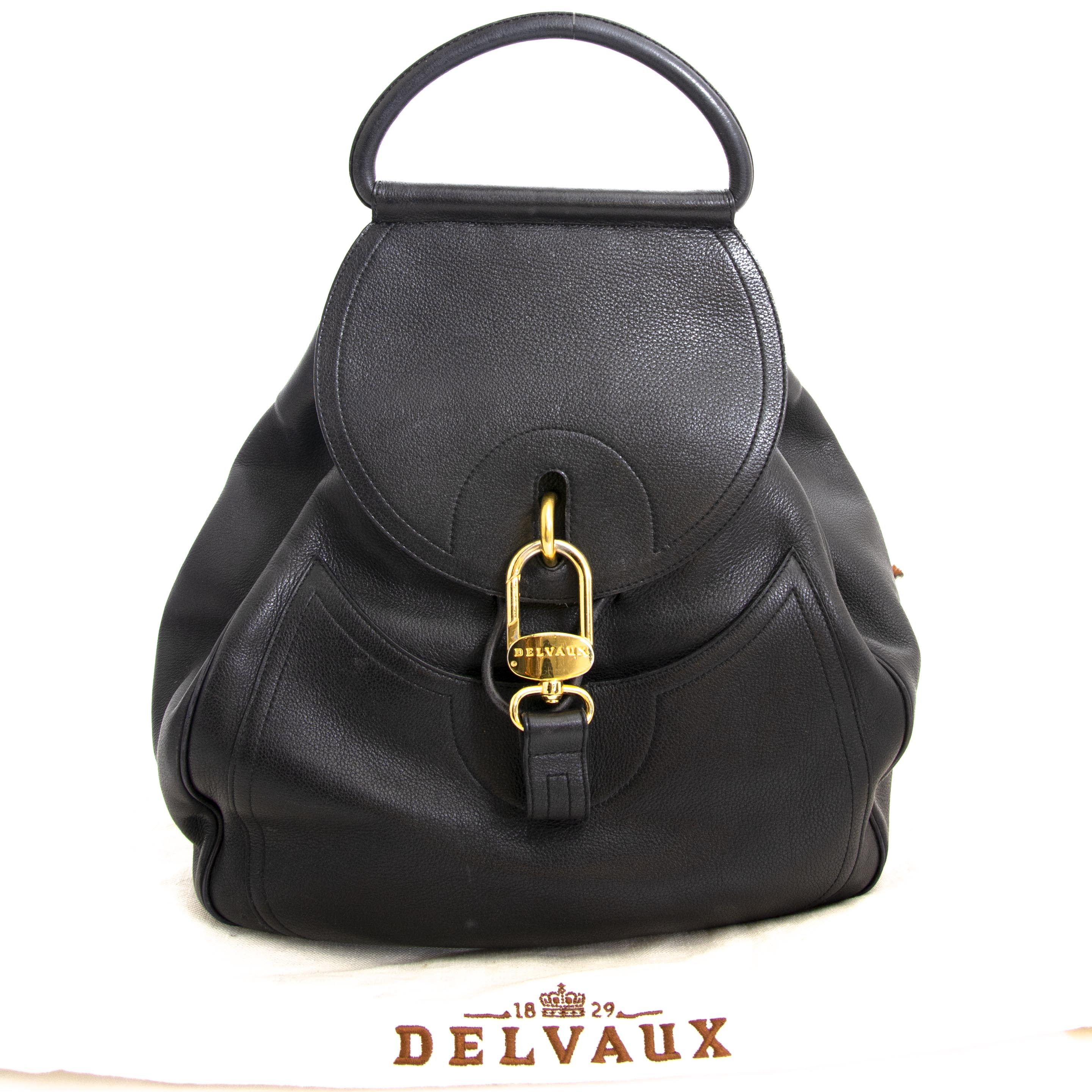 Travel handsfree in style wherever you go, with this all black Delvaux Leather Lucifer GM bag. veilig online aankopen tegen de beste prijs