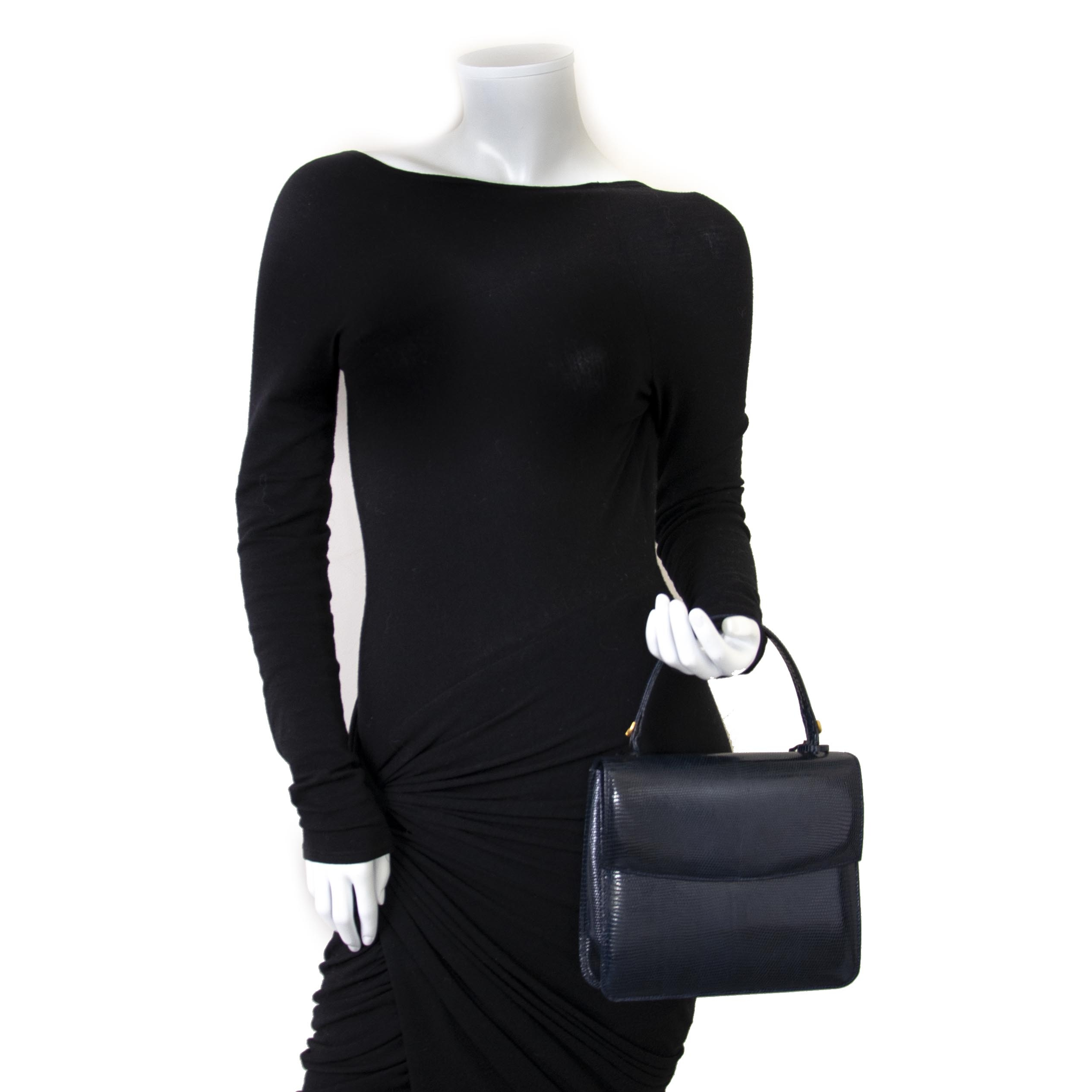 We buy and sell your authentic Delvaux Blue Lizard Top Handle Bag