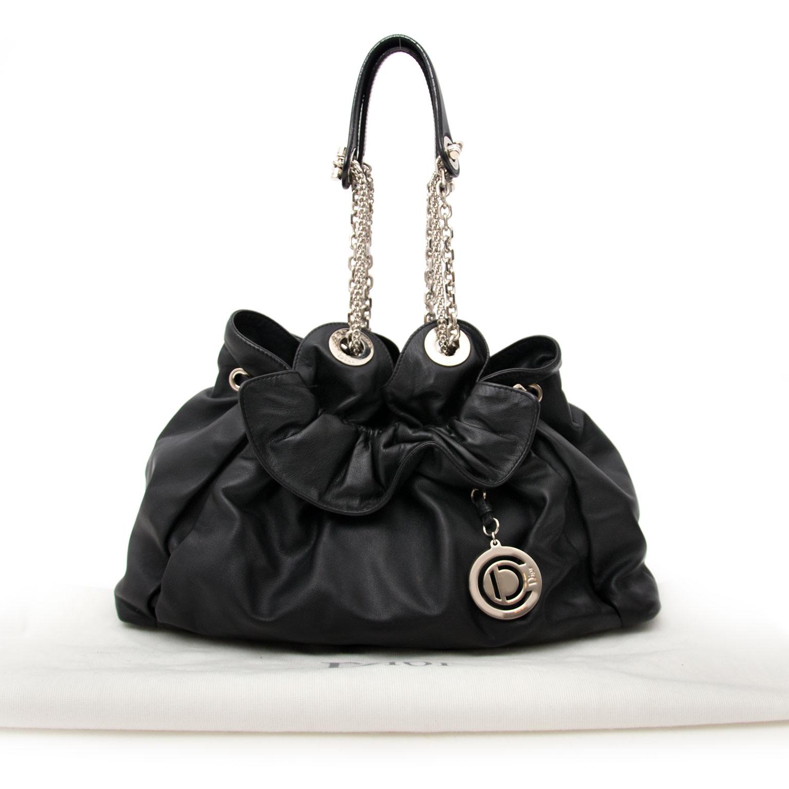 25690ba52be3 ... koop jou tweedehands handtas veilig Constructed of supple lambskin  leather with Dior s signature
