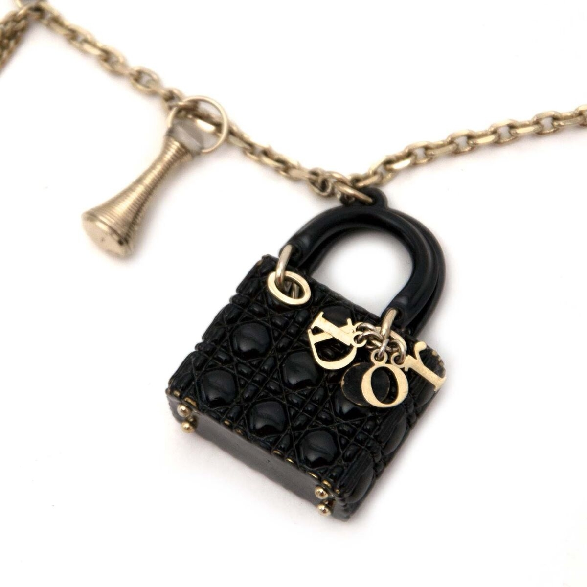 Buy authentic secondhand Dior charm necklace at the right price at LabelLOV vintage webshop. Safe and secure online shopping.