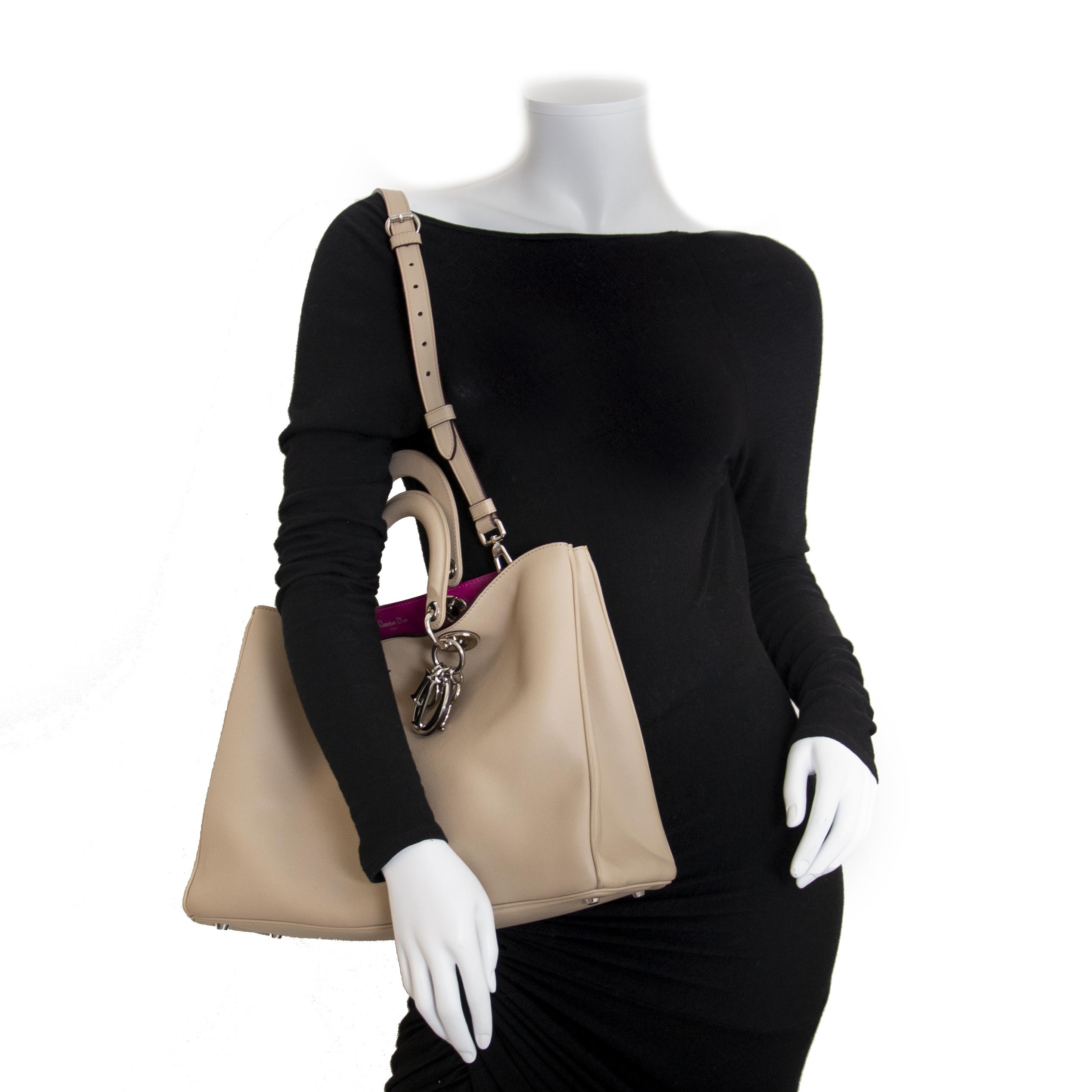 Dior Diorissimo Beige Calfskin Bag with Fuschia Interior for sale kopen en verkopen aan de beste prijs