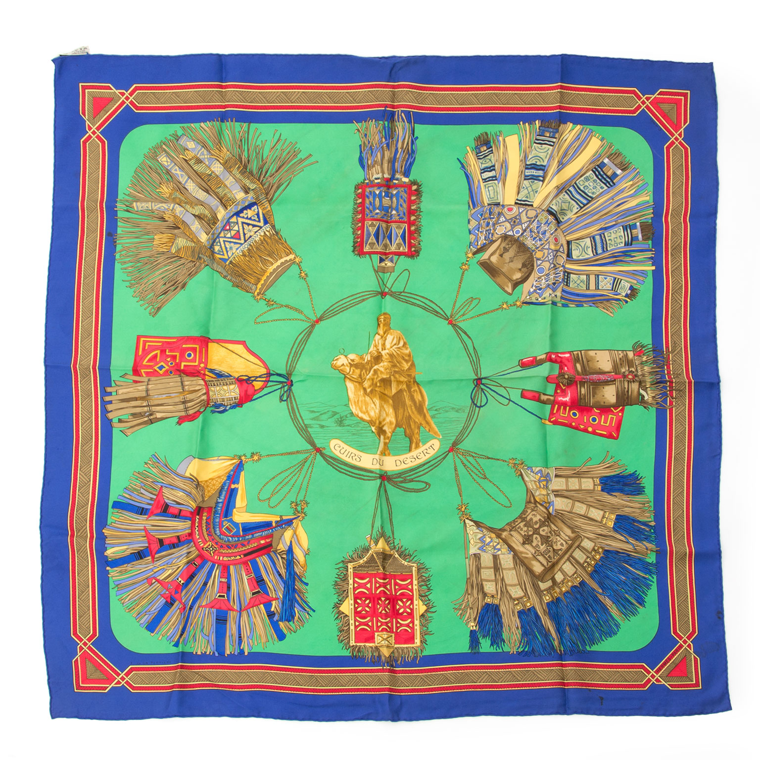 Preowned Hermès Silk Carré Scarf Cuirs Du Desert Green Blue.   Buy authentic secondhand Hermès scarves at the right price at LabelLOV vintage webshop.  Safe and secure online shopping. Koop authentieke tweedehands Hermès sjaals met de juiste prijs bij Lab