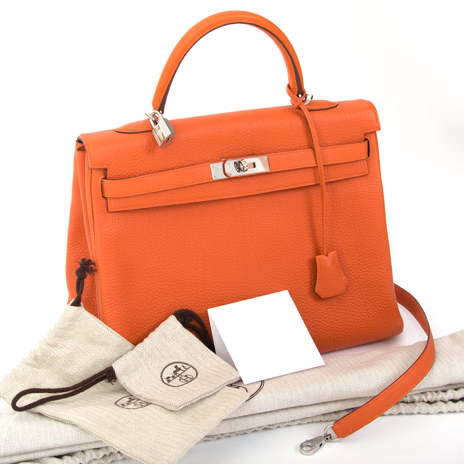 shop online Hermes Orange Kelly 35 Retourne Veau Togo  in perfect condition at the best price