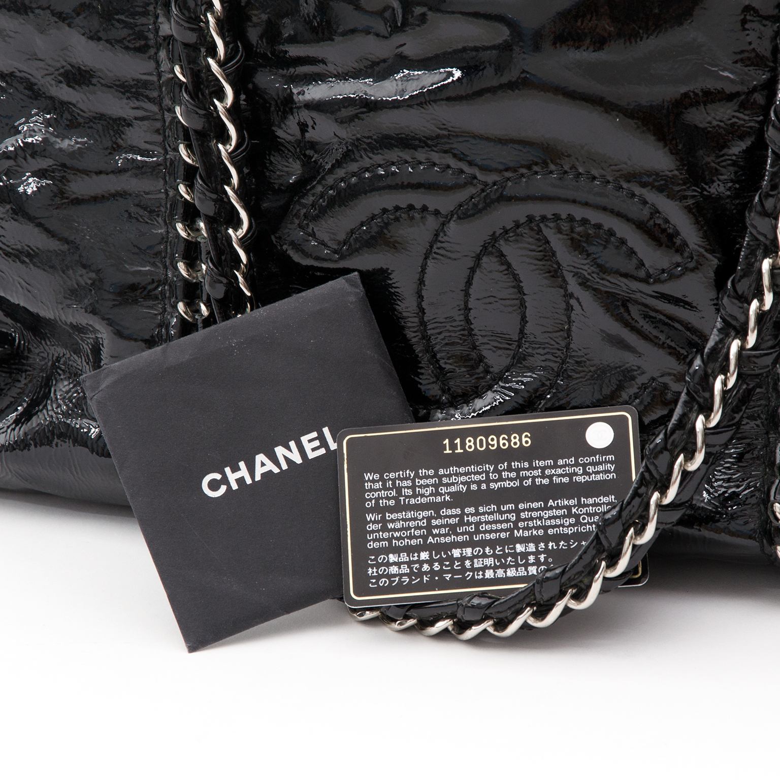 a89d7e9a846b ... bags vintage This Chanel tote has a high-gloss patent leather exterior  and metallic interior lining.