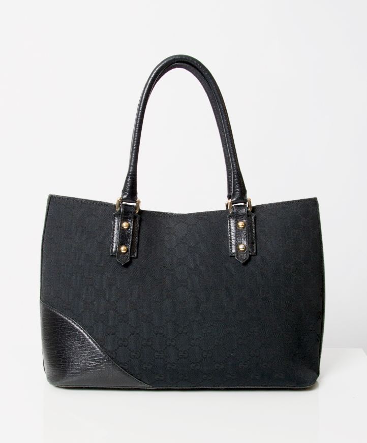 8bd47cc99 ... tweedehands Gucci Black Canvas Monogram Tote Bag with gold plated  signature stirrup detail. Canvas body