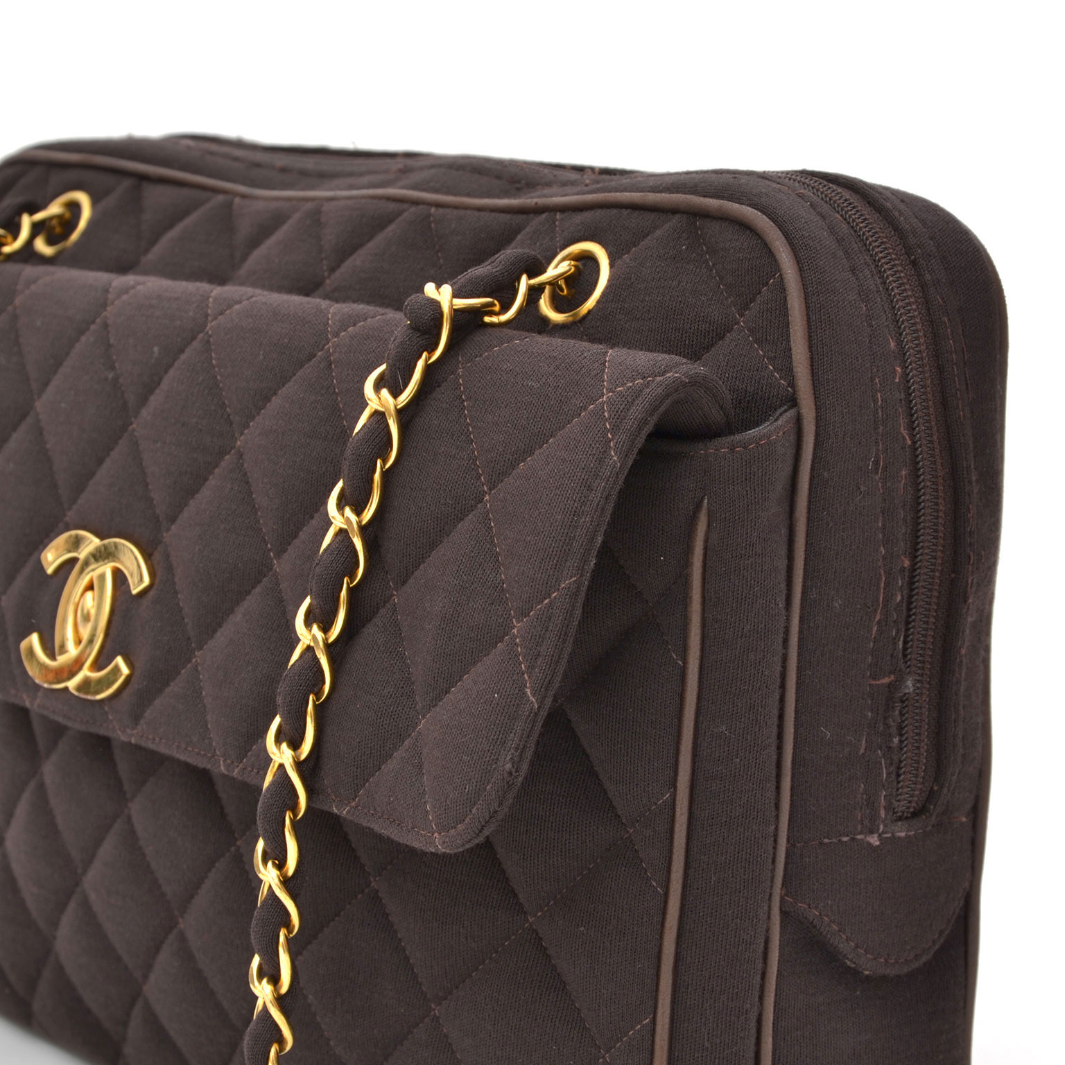 7852b3dea180 Shop secondhand authentic Chanel handbags at LabelLOV. Chanel Quilted Brown  Fabric Jersey Messenger Bag. Find authentic vintage Chanel handbags for the  ...
