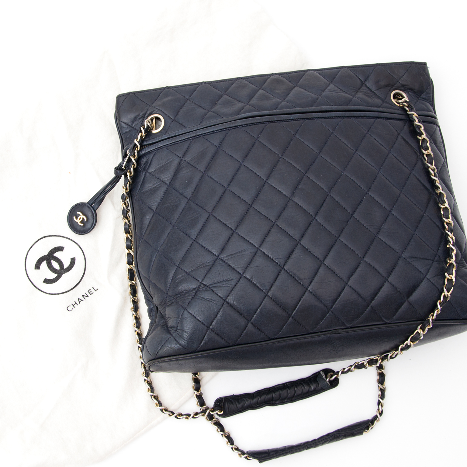 5e8aa5951c04 Buy authentic secondhand Chanel bags at the right price Chanel Navy Quilted  Lambskin Tote This is a real vintage find! A Chanel tote with