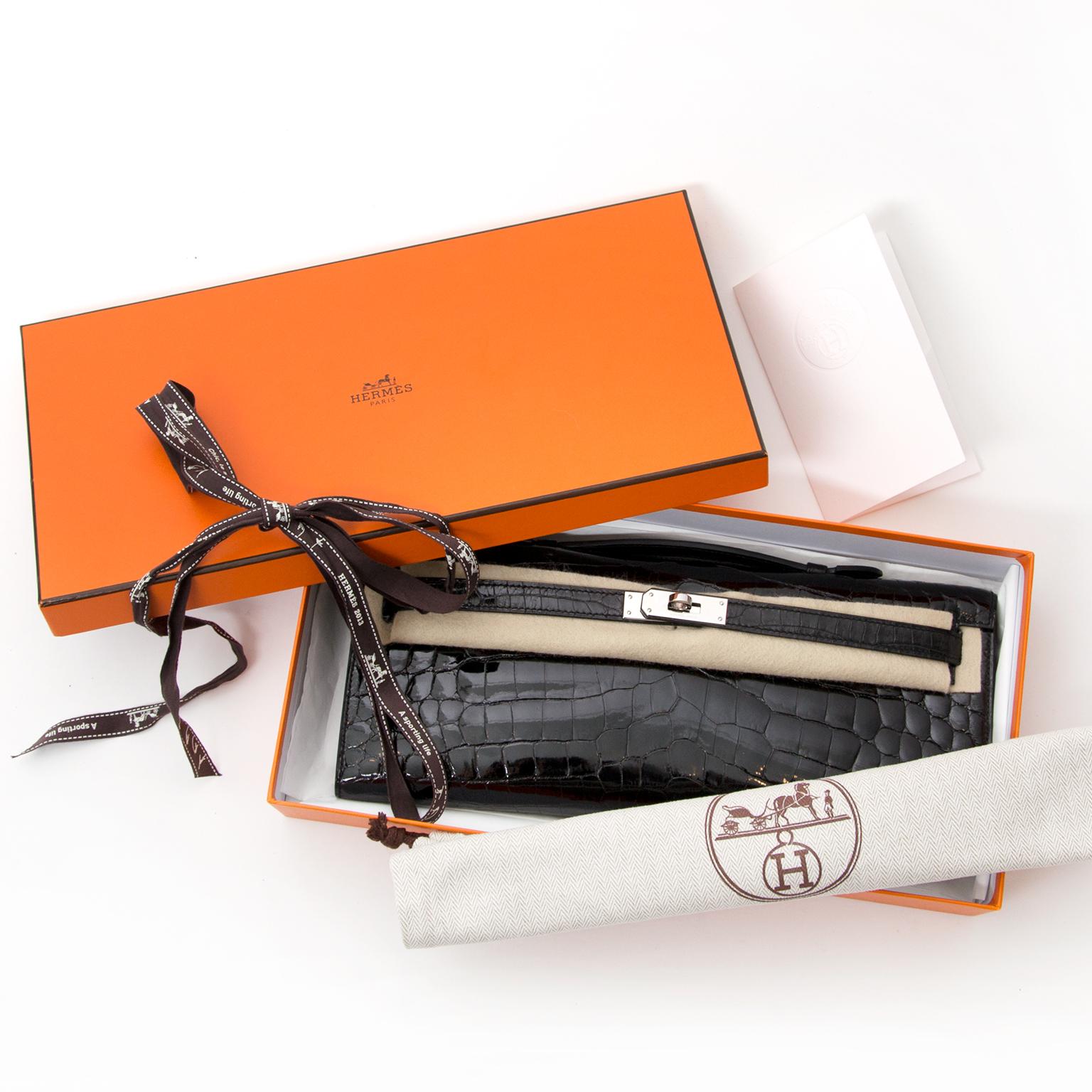 Hermès Clutch Pochette Kelly Crocodile Niloticus Lisse Noir koop veilig en snel online tweedehands Hermes Kelly net als nieuw beste prijs 100% echt