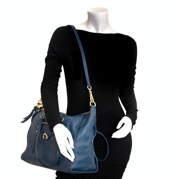 Acheter en ligne seconde main Louis Vuitton Infini Empreinte Lumineuse bag.