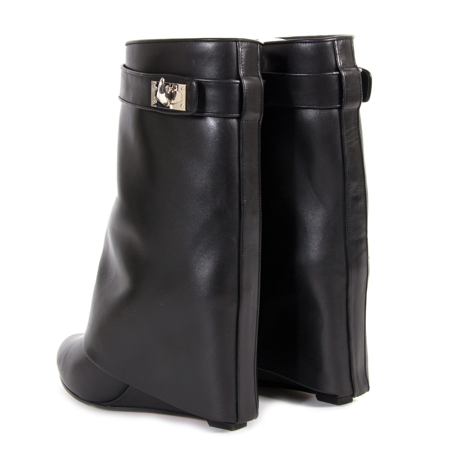 Are you interested in an authentic pair of Givenchy Black Shark Lock Boots?