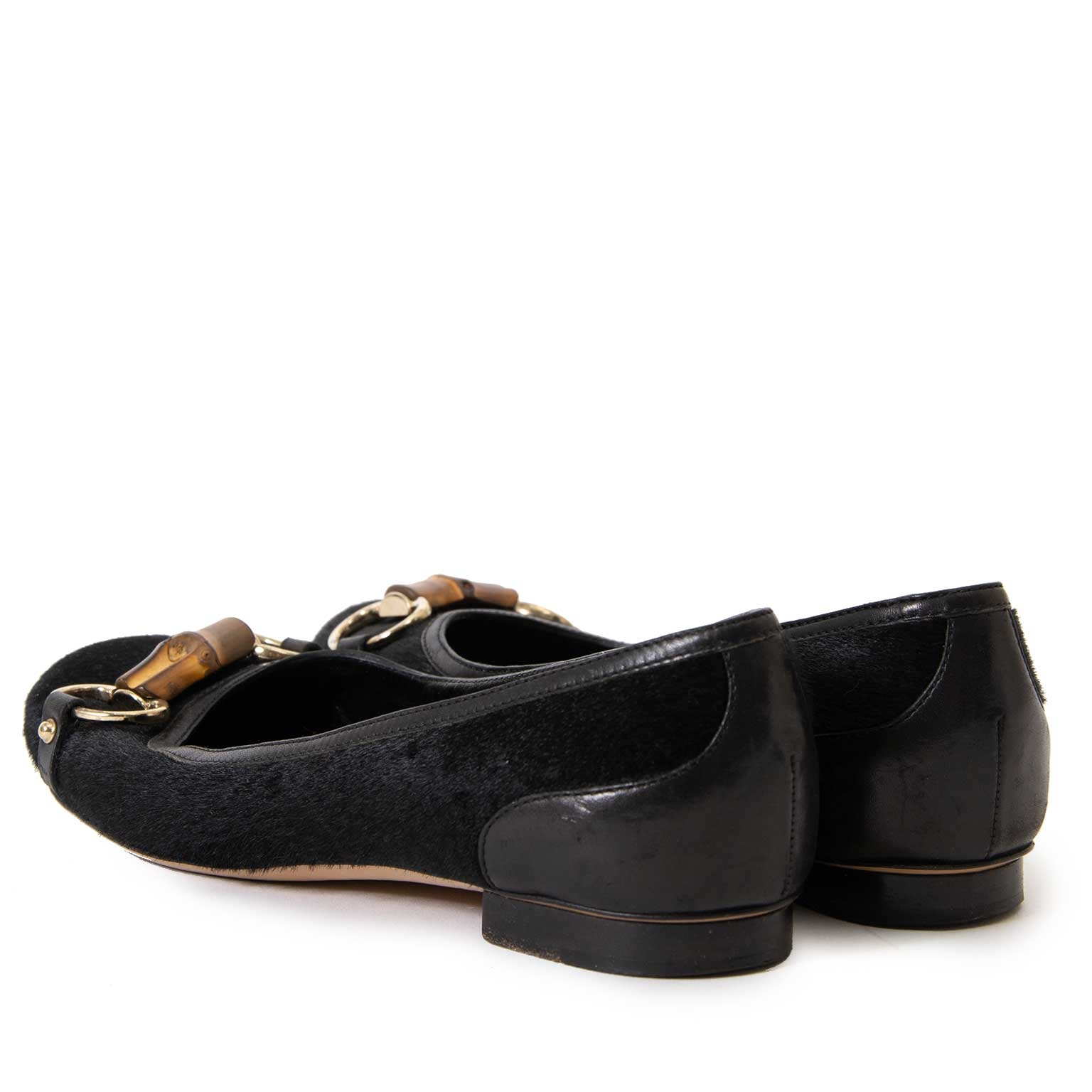 bb92fe674ce ... buy Gucci Black Ponyhair Horsebit Flats - Size 37 at labellov for the best  price