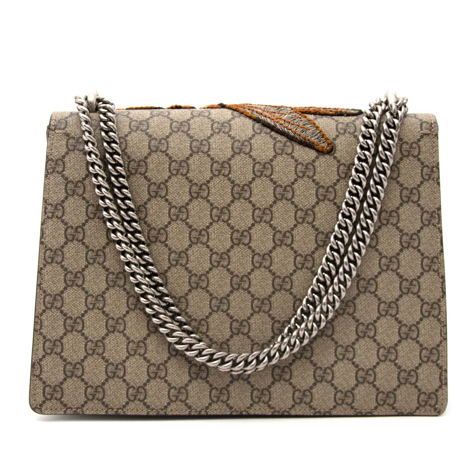 acheter en ligne pour le meilleur prix Gucci Monogram Bee Dionysus Medium shoulder bag