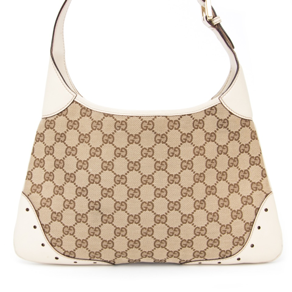 056ada5eb086 Gucci Buy Gucci Monogram Shoulder bag with white trim and gold buckle. at  the right price