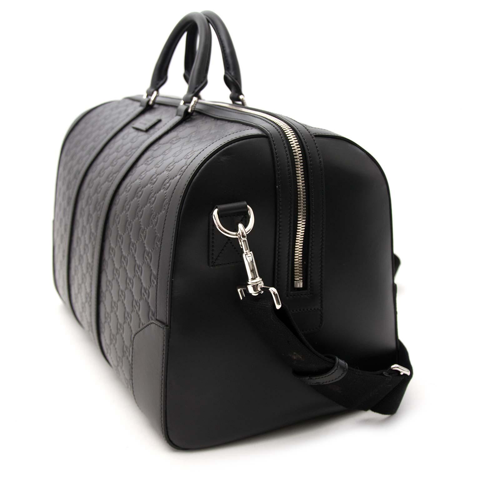 acheter en ligne pour le meilleur prix seconde main comme neuf 100% authentic Gucci Signature leather duffle Weekender