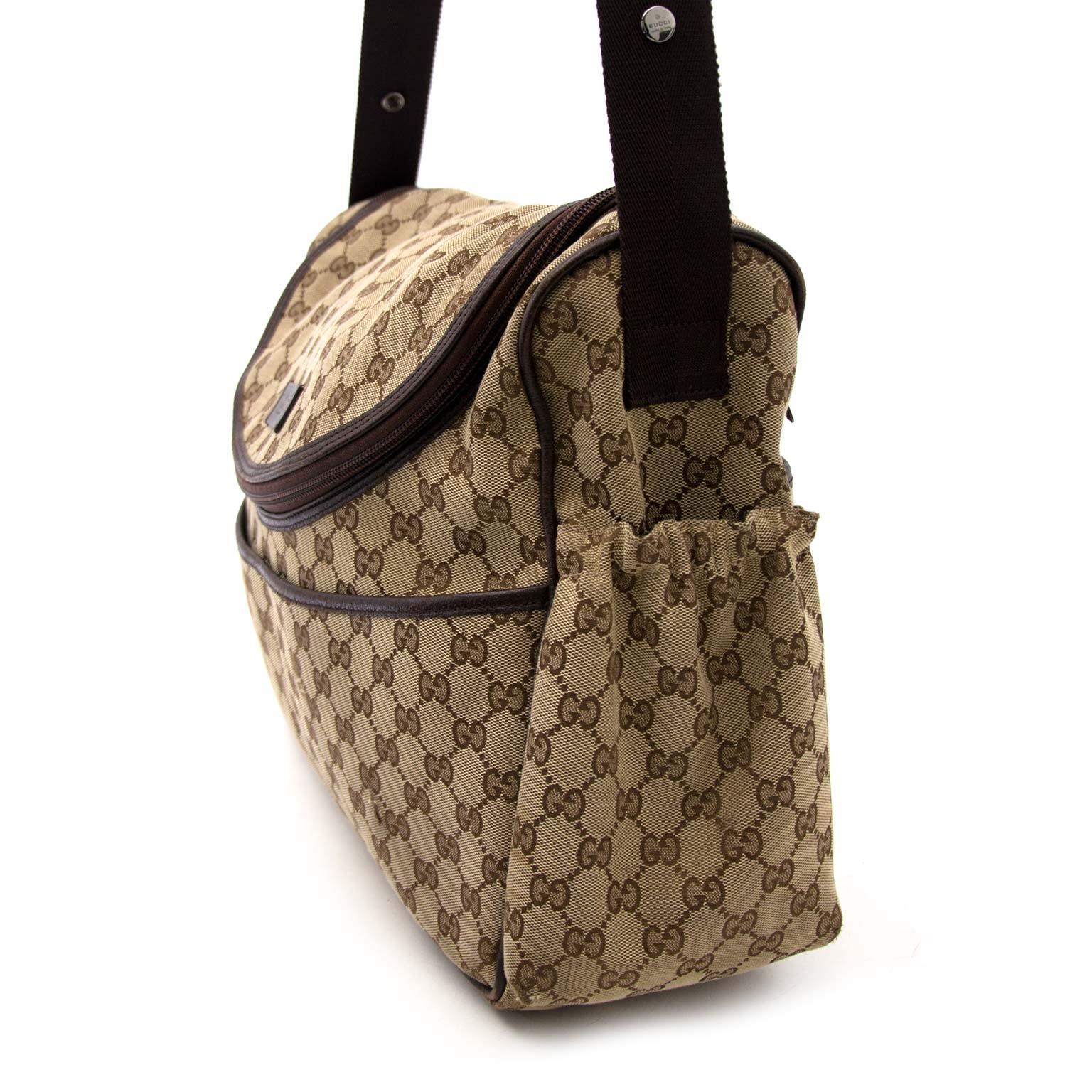 Gucci Monogram Diaper Bag Buy authentic designer Gucci secondhand bags at Labellov at the best price. Safe and secure shopping. Koop tweedehands authentieke Gucci tassen bij designer webwinkel labellov.