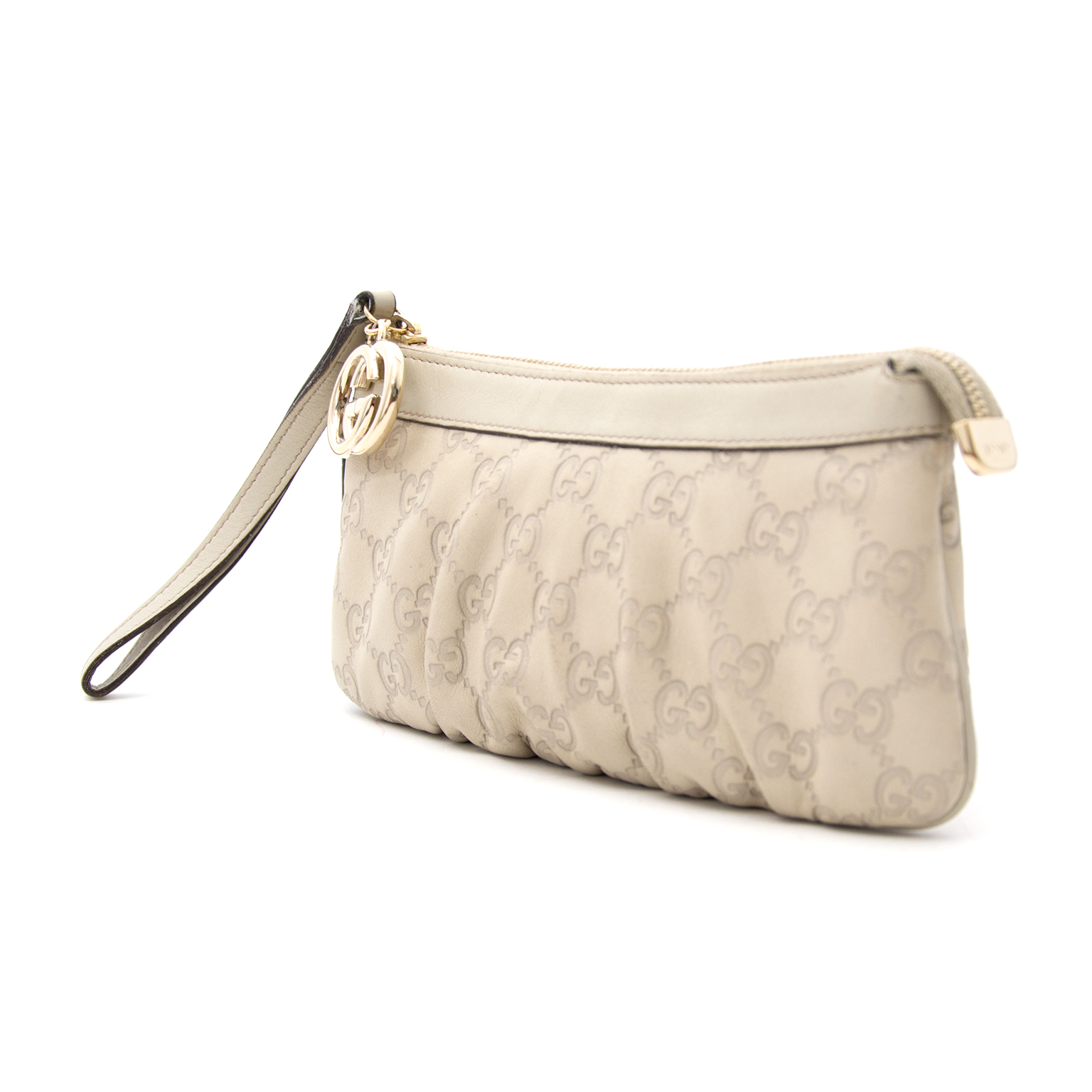 Gucci Creamy Colored Leather Guccissima Clutch now online at labellov.com for the best price.