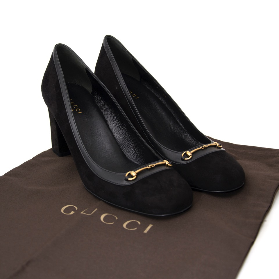 Buy Brand New  Gucci black heels in suede with gold detail.  at the right price at LabelLOV vintage webshop. Luxe, vintage, fashion. Safe and secure online shopping. Antwerp, Belgium.