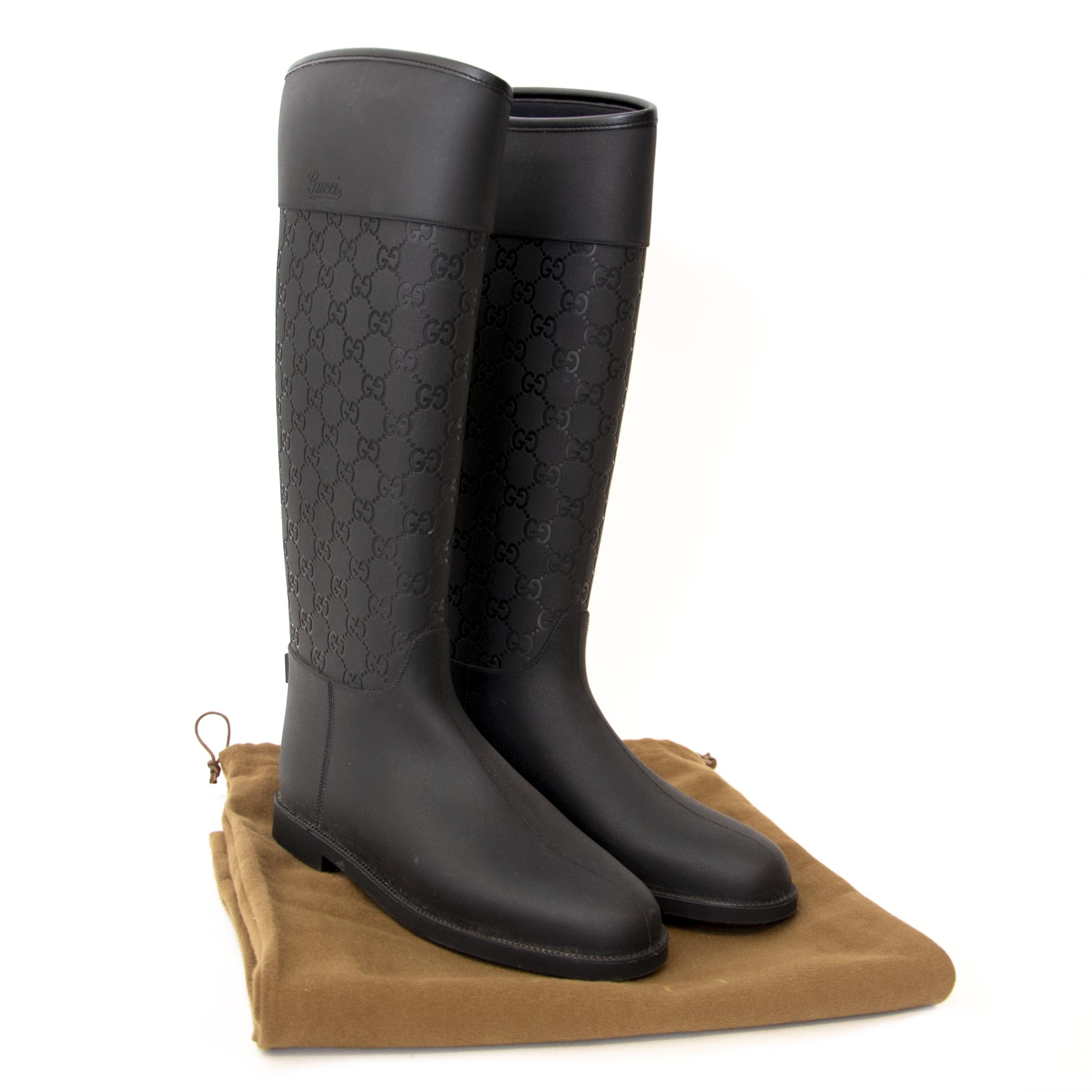 fcb44d855cc ... secondhand We buy and sell your authentic Gucci Monogram Rubber Boots  for the best price