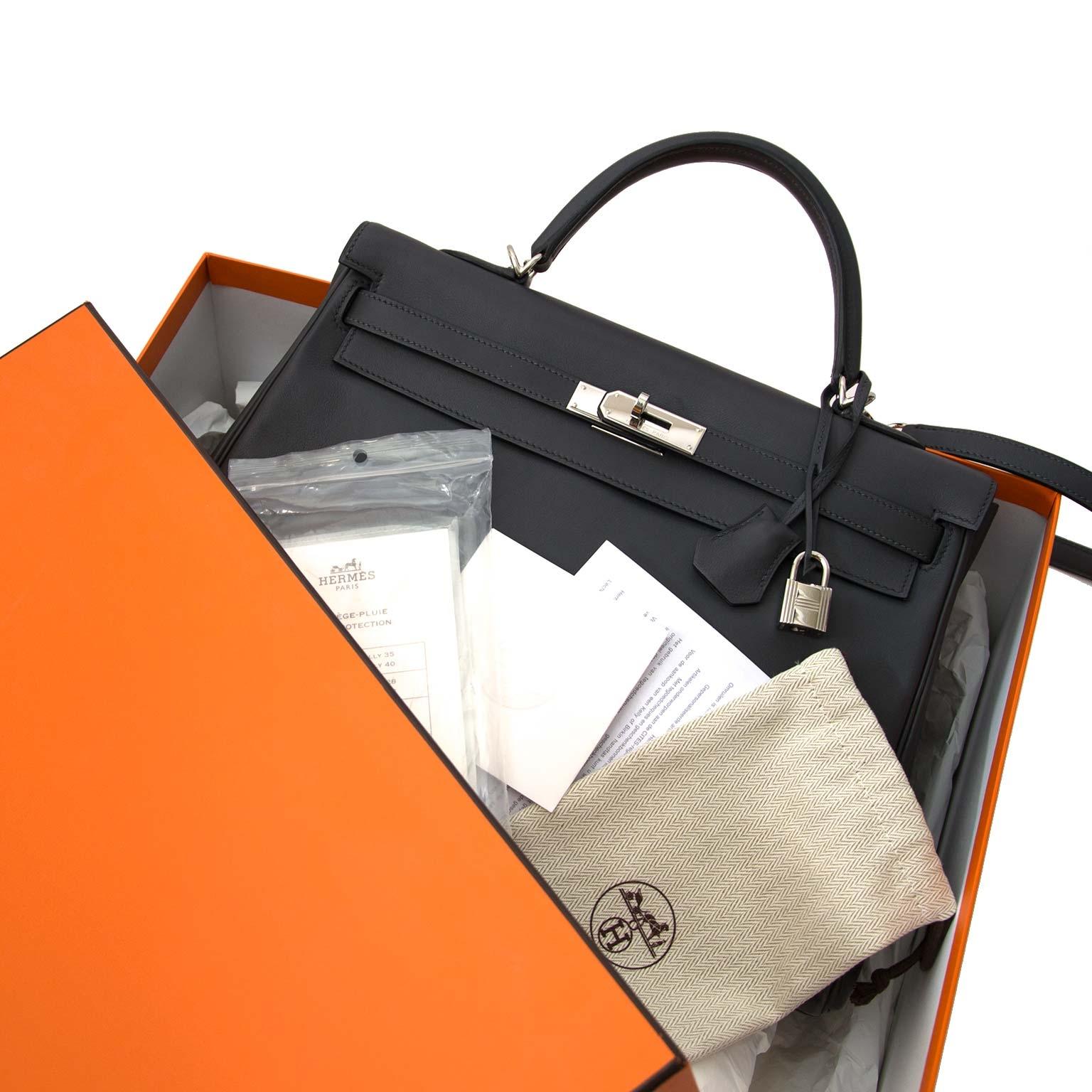 koop online jou tweedehands authentic  Hermes Kelly 35 Retourne Ardoise Swift PHW online at the best price