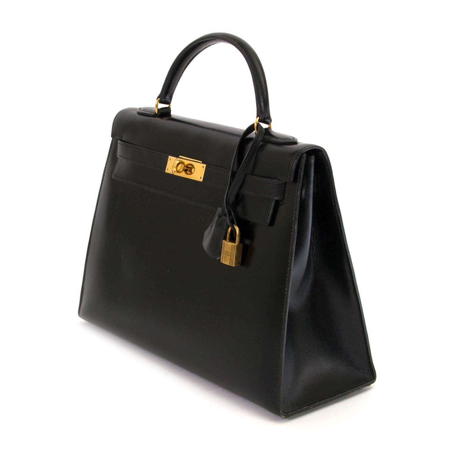 Hermès Kelly 32 Black Box Calf GHW kopen en verkopen aan de beste prijs bij Labellov