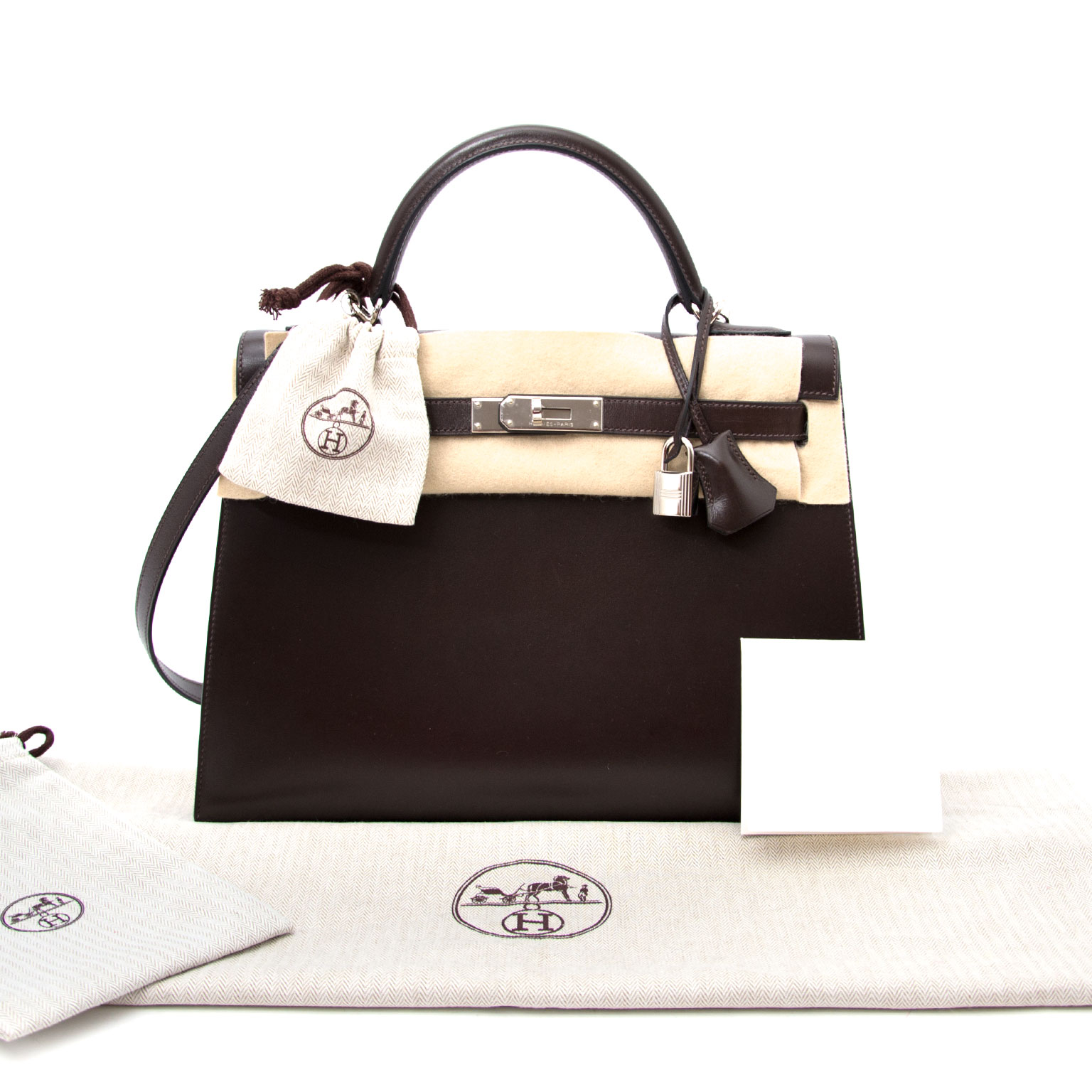 Buy a secondhand Hermes Kelly Chocolate 32  + Strap at the right price