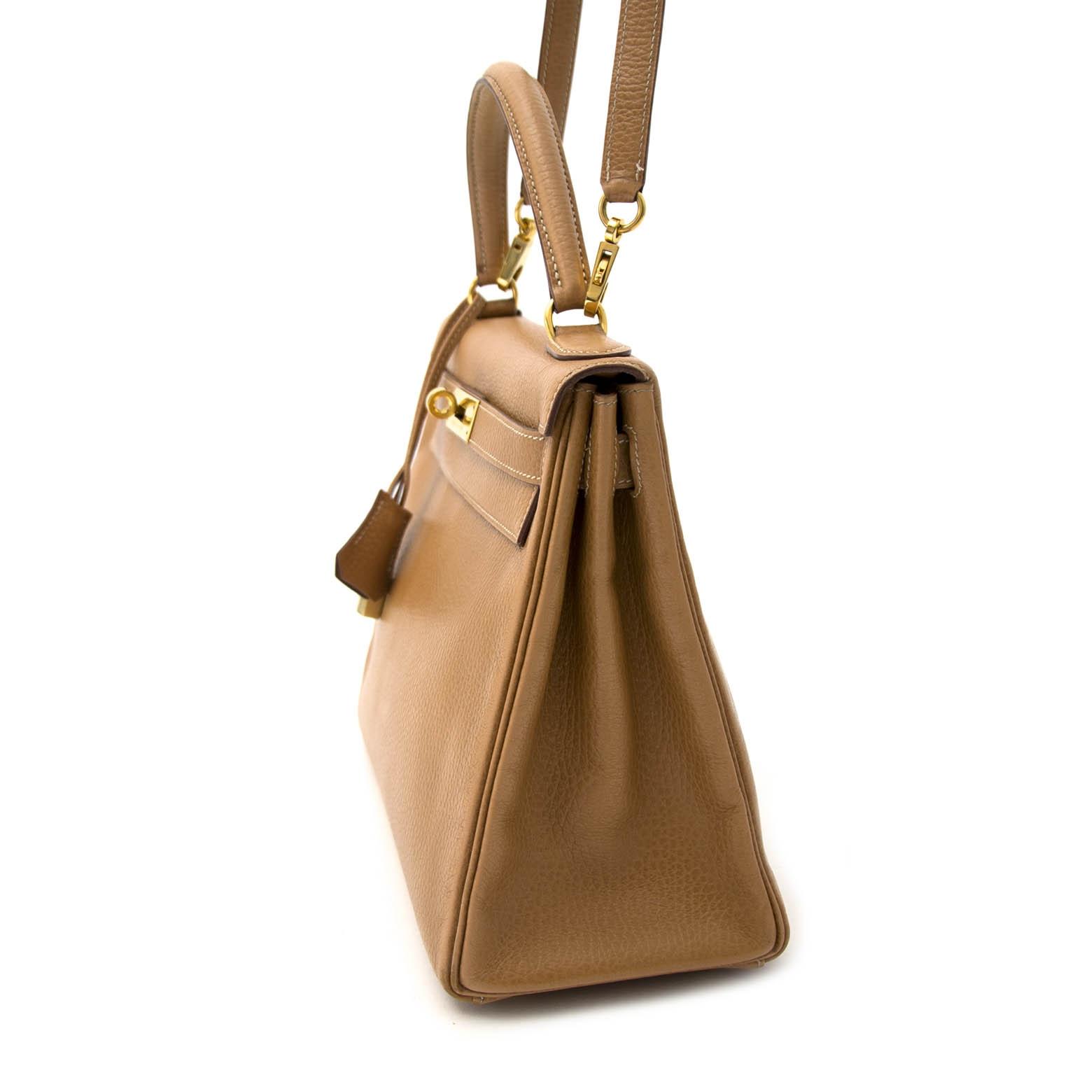 acheter en ligne seconde main Hermès Caramel Kelly 28  Fache Liegee GHW