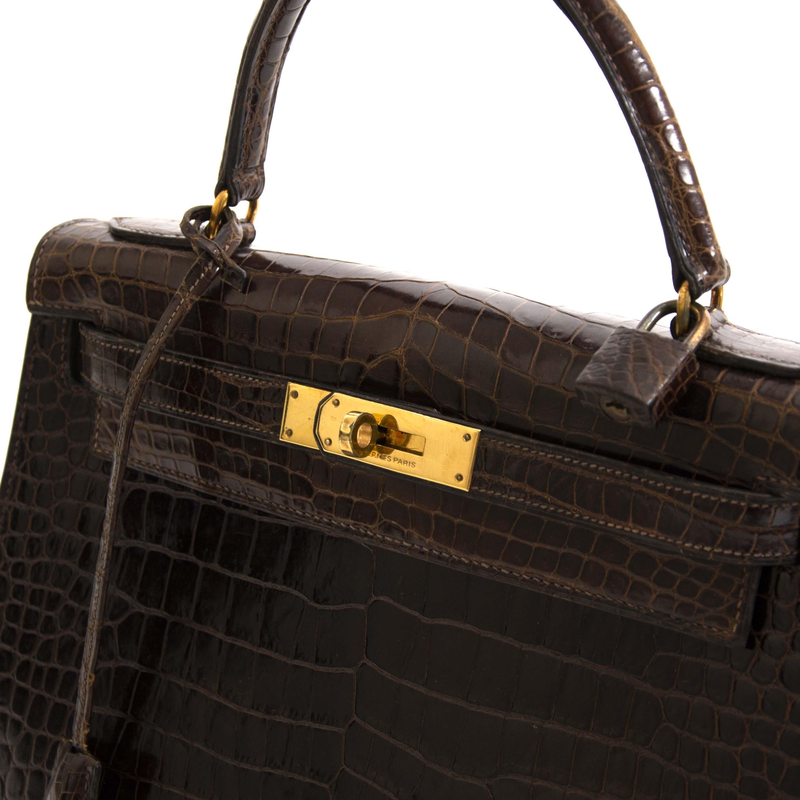 Hermès Kelly 28 Brown Croco Vintage GHW te koop aan de beste prijs bij Labellov tweedehands luxe