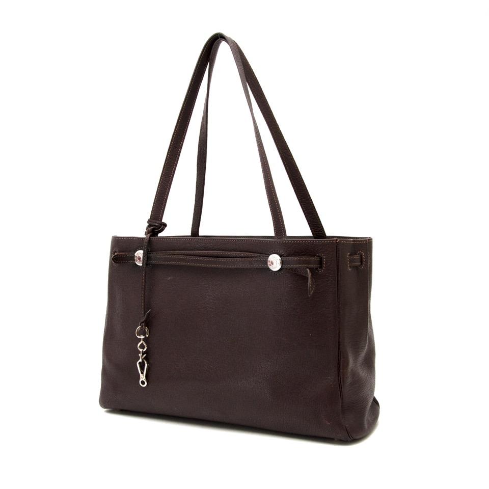 Op zoek naar een Hermes Brown Leather Her Bag Cabas Tote? Koop veilig online.