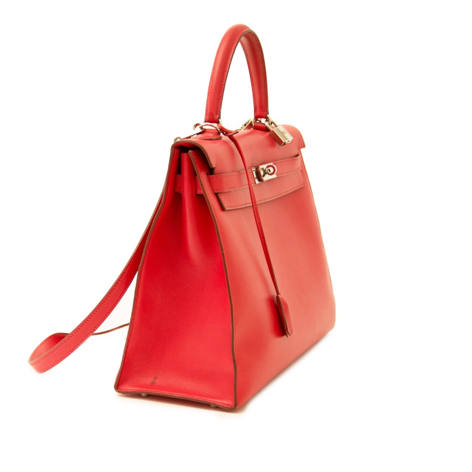 Buy vintage Hermes Kelly 35 Bougainvillea Red Swift PHW with strap at the right price at LabelLOV vintage webshop. Luxe, vintage, fashion. Safe and secure online shopping. Antwerp, Belgium.