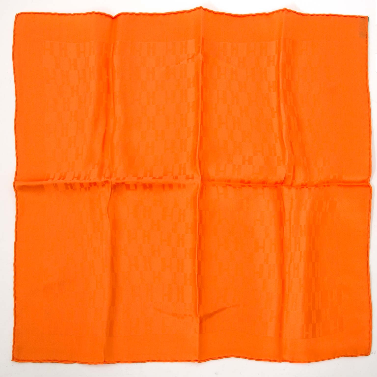 Buy your authentic Hermès Orange Façonnée H Logo Scarf  for the best price