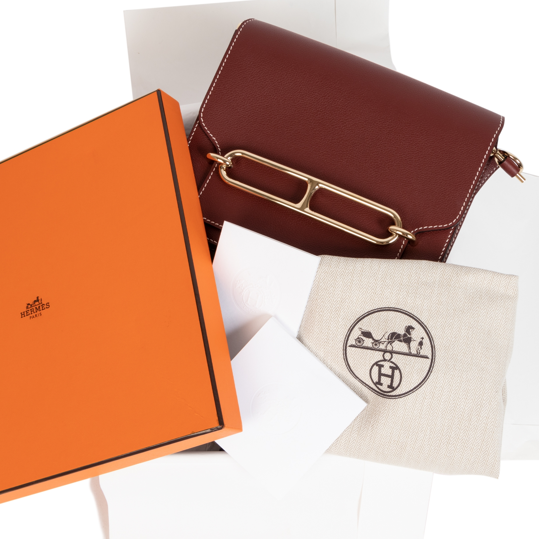 Are you looking for an authentic designer Hermès Roulis veau Evercolor Rouge H ?