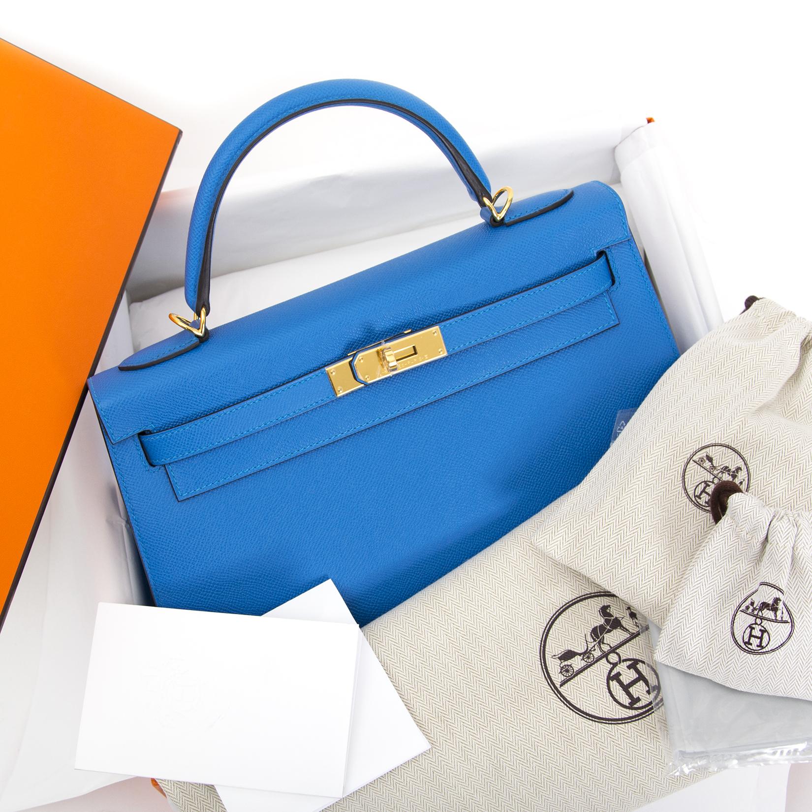Hermès Kelly 32 Blue Zanzibar Epsom GHW for sale online at Labellov