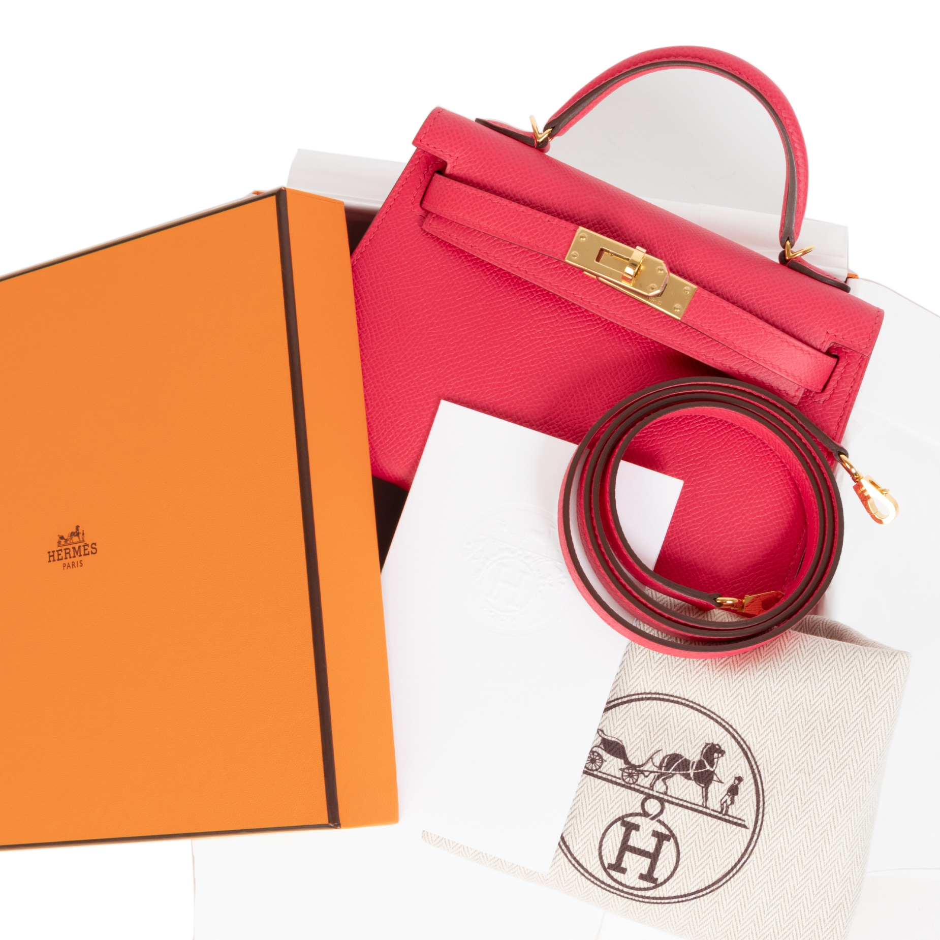 We buy an dsell your authentic Hermès Kelly II Mini Epsom Rose Extreme GHW