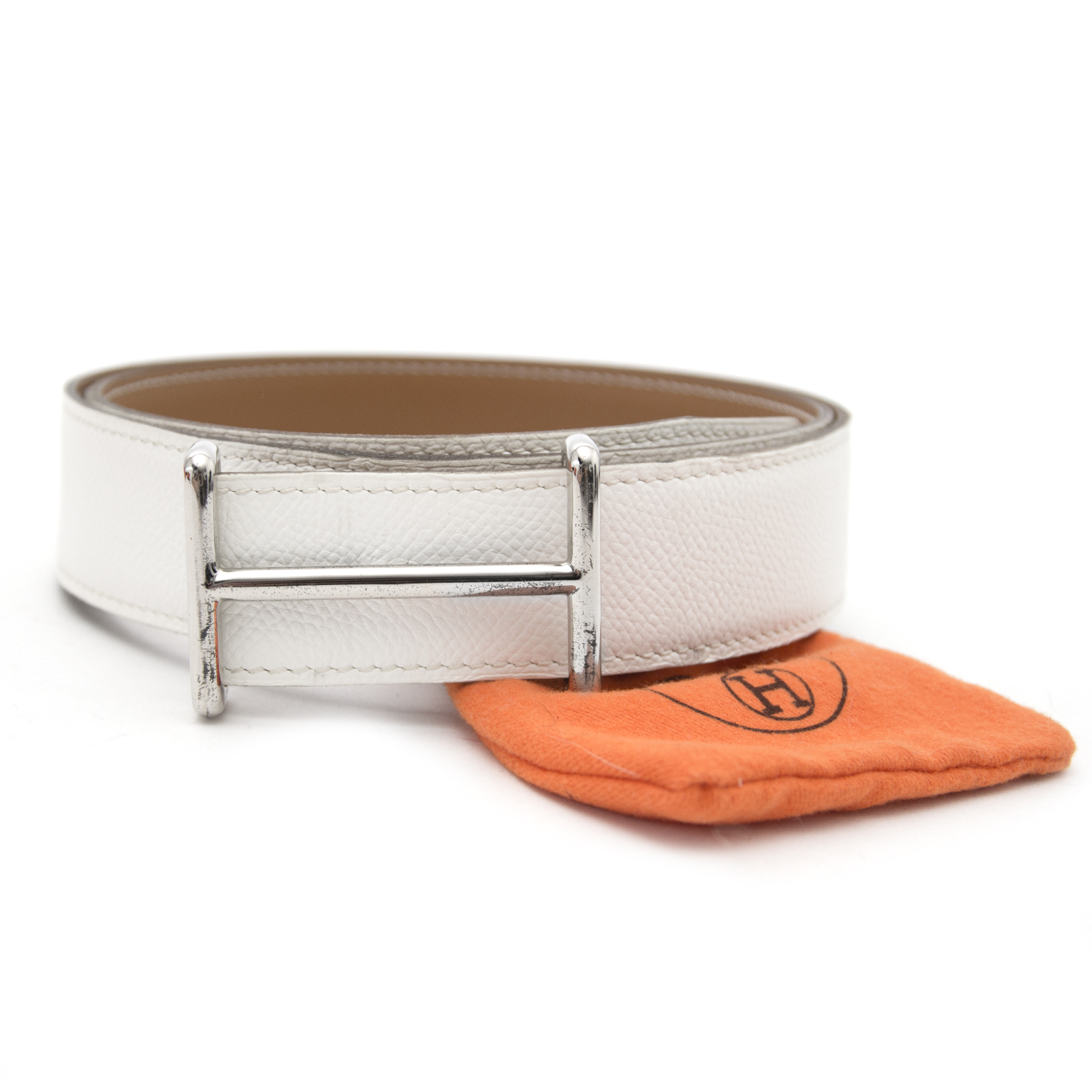 Bent u opzoek naar een Hermès Reversible White/Gold H Buckle PHW Belt?