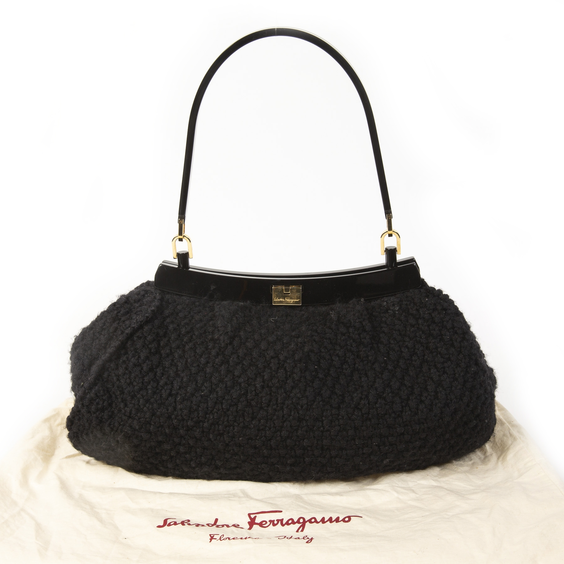 Salvatore Ferragamo Black Wool Knitted Shoulder Bag.  Buy authentic Salvatore Ferragamo Bag at the right price at LabelLOV vintage webshop. Shop safe and secure online. Koop authentieke Salvatore Ferragamo tas aan de juiste prijs bij LabelLOV .
