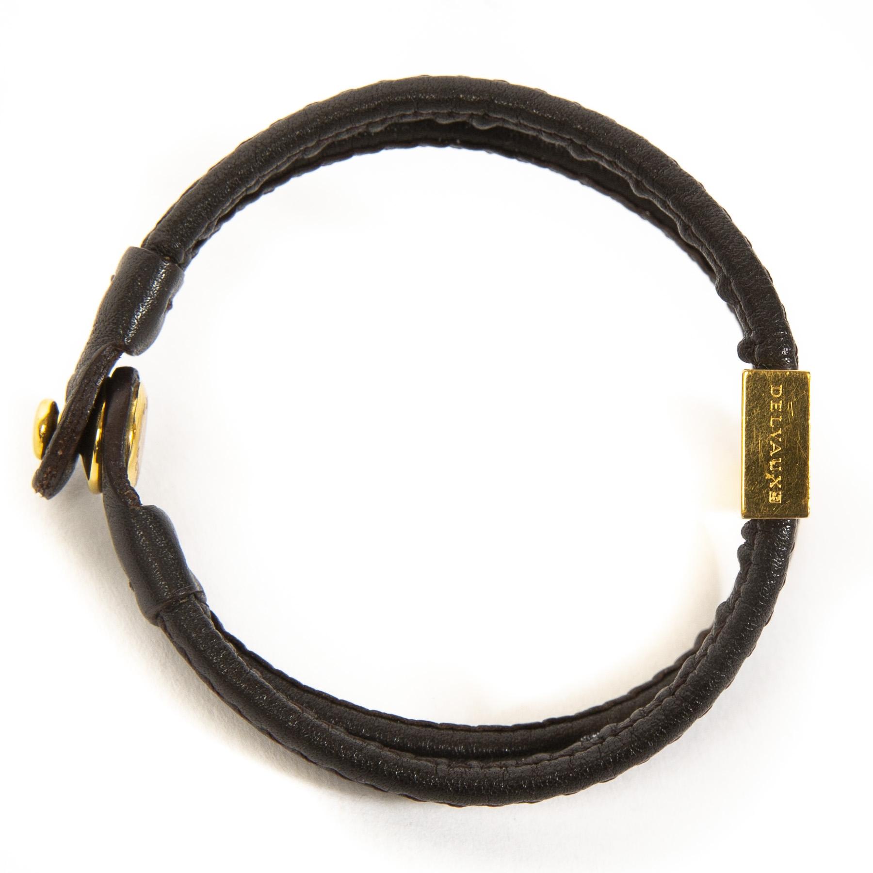 Delvaux Brown Déclic Bracelet. Buy authentic secondhand designer items from delvaux at labellov antwerp. Koop online tweedehands delvaux armband bij labellov antwerpen. veilige betaling, paiement sécurisé. Designer vintage.