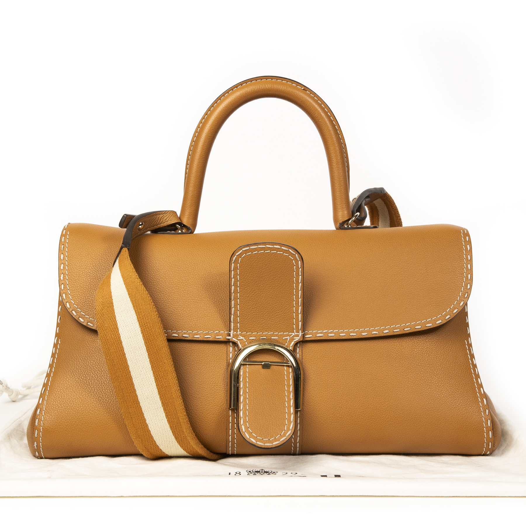 Delvaux Brillant East/West Tote Bag in Brown Clemence Leather with Large Stitch and Special Strap.  Buy authentic delvaux bag online at labellov webshop antwerp, secondhand designer vintage. Koop online tweedehands delvaux tas brillant bij labellov.