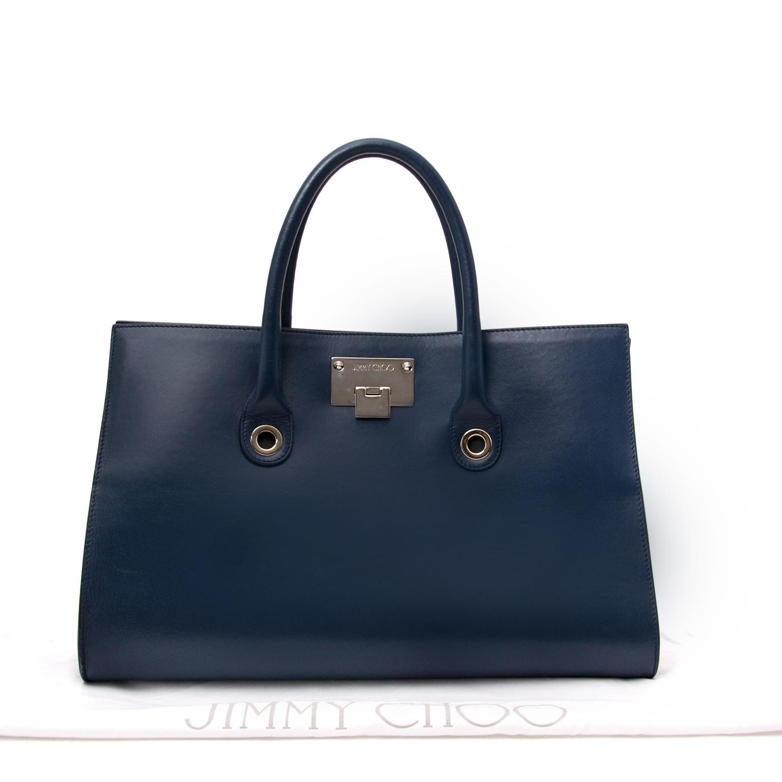 Jimmy Choo Navy Blue Handtasche heute online auf labellov.com gegen den besten Preis.