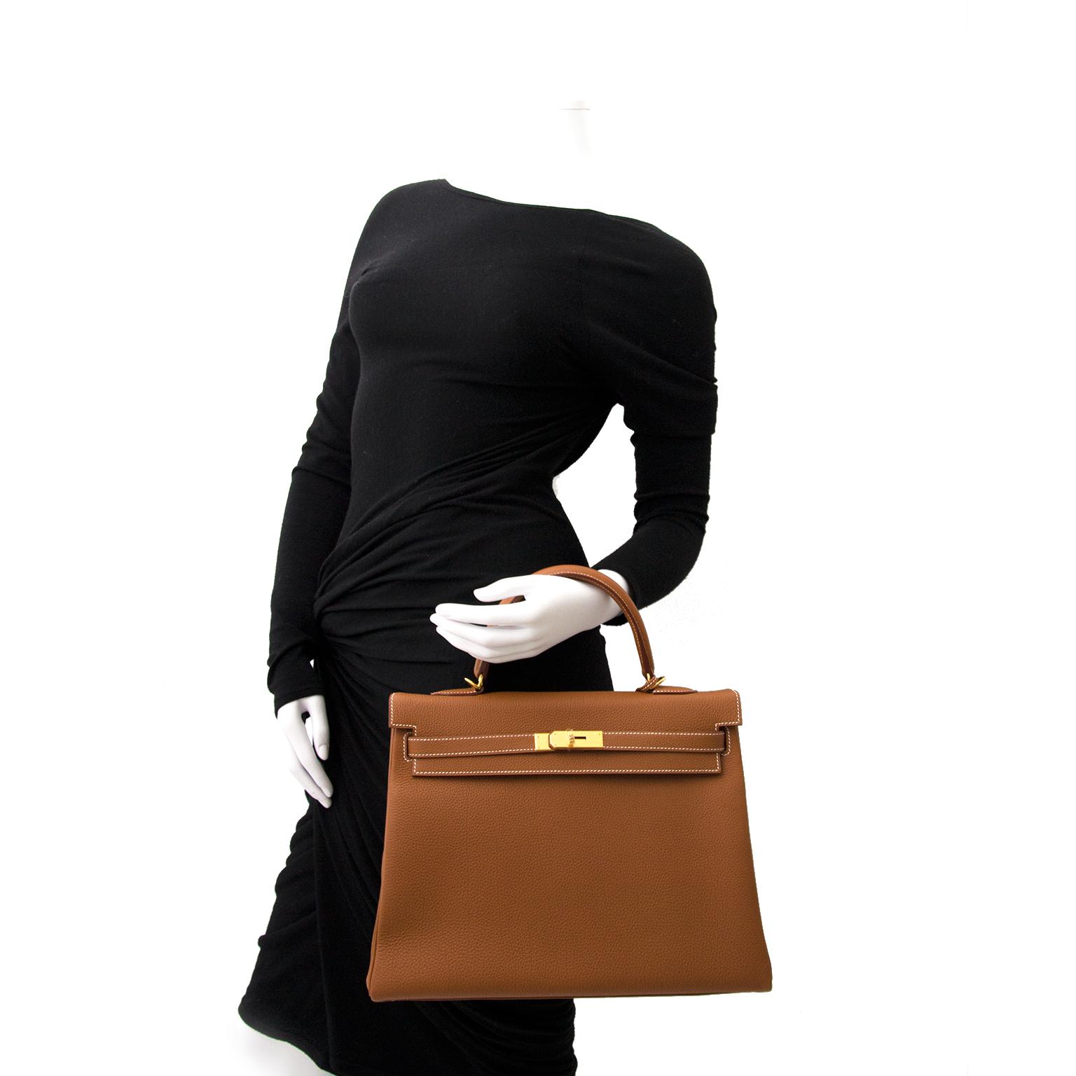 Koop veilig online Nieuwe Hermes Kelly 35 Gold GHW handtas